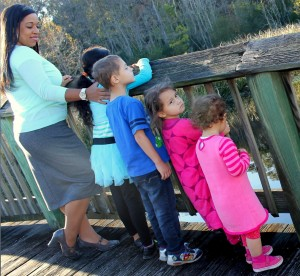 Ashley from smartandsavvymom with kids on bridge