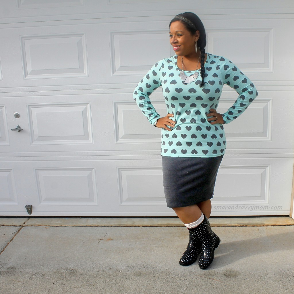 light blue long sleeve top with gray hearts, rain boots, and braided hair; modest outfit idea