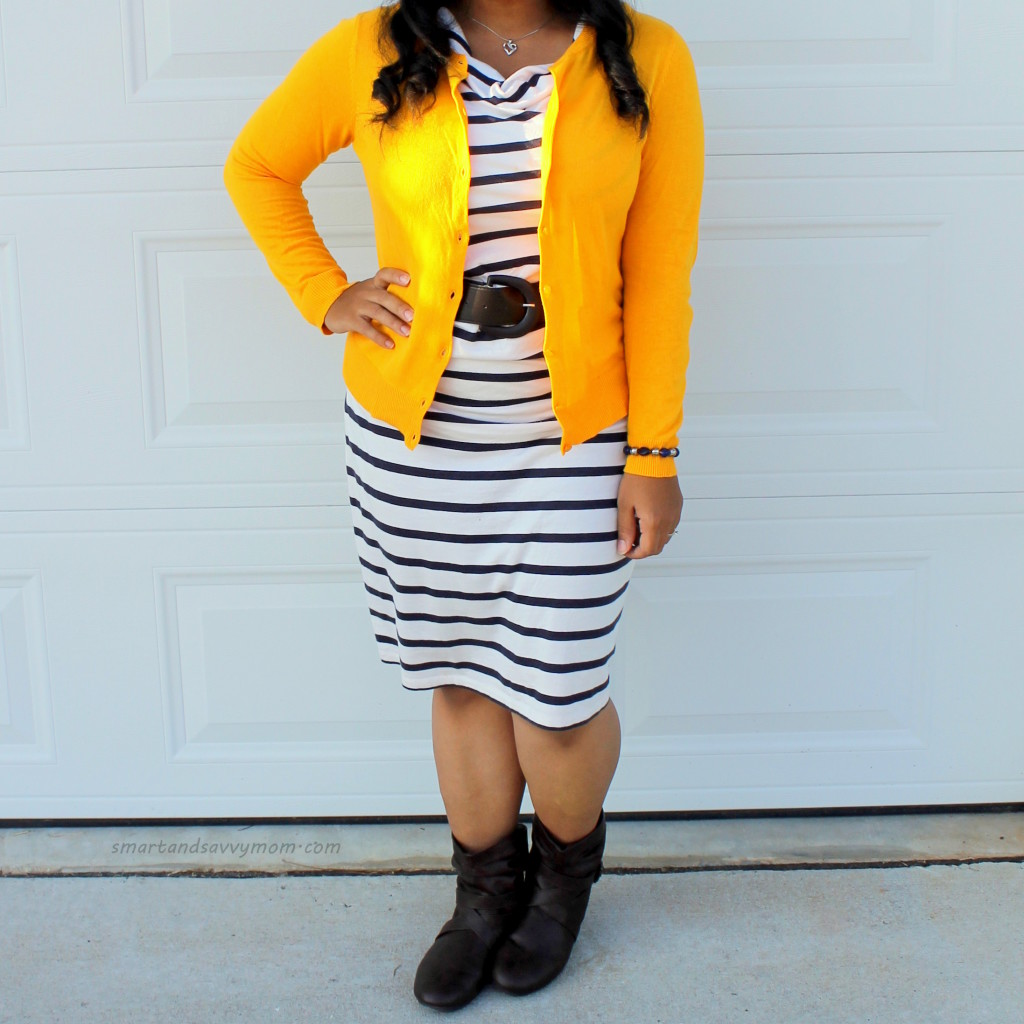 Mustard yellow sweater and striped dress. Brown boots and brown belt easy teacher outfit