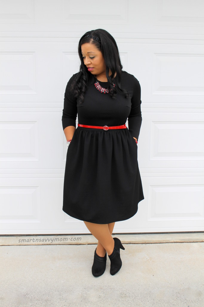 long sleeve black modest dress with pops of red and booties