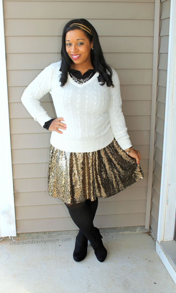 white cable knit sweater layered over black button up top, gold sequin skirt, black tights and booties. Modest holiday/christmas outfit idea