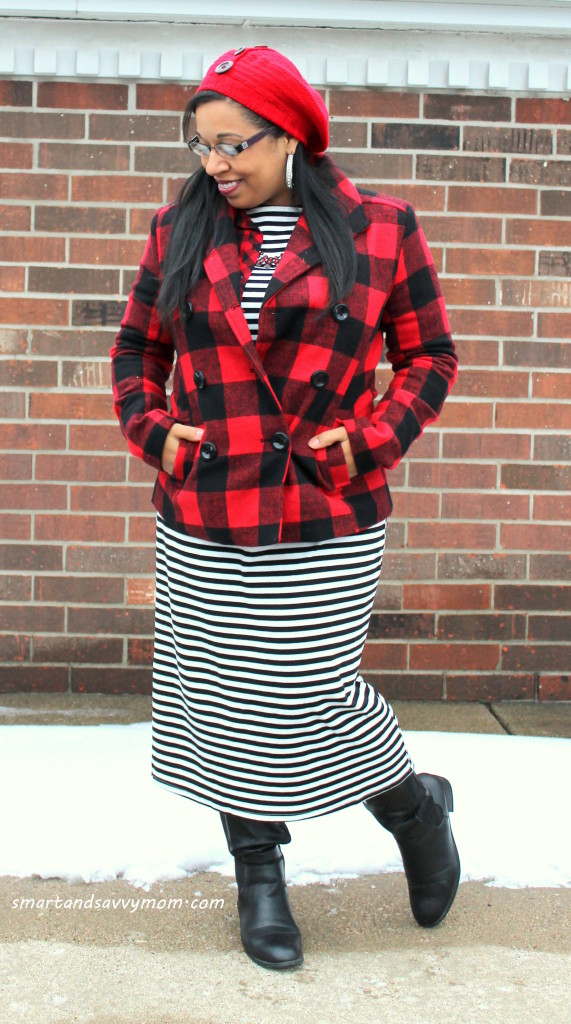 red buffalo plaid winter coat pattern mix with black and white striped dress and black knee hight boots, modest winter outfit idea