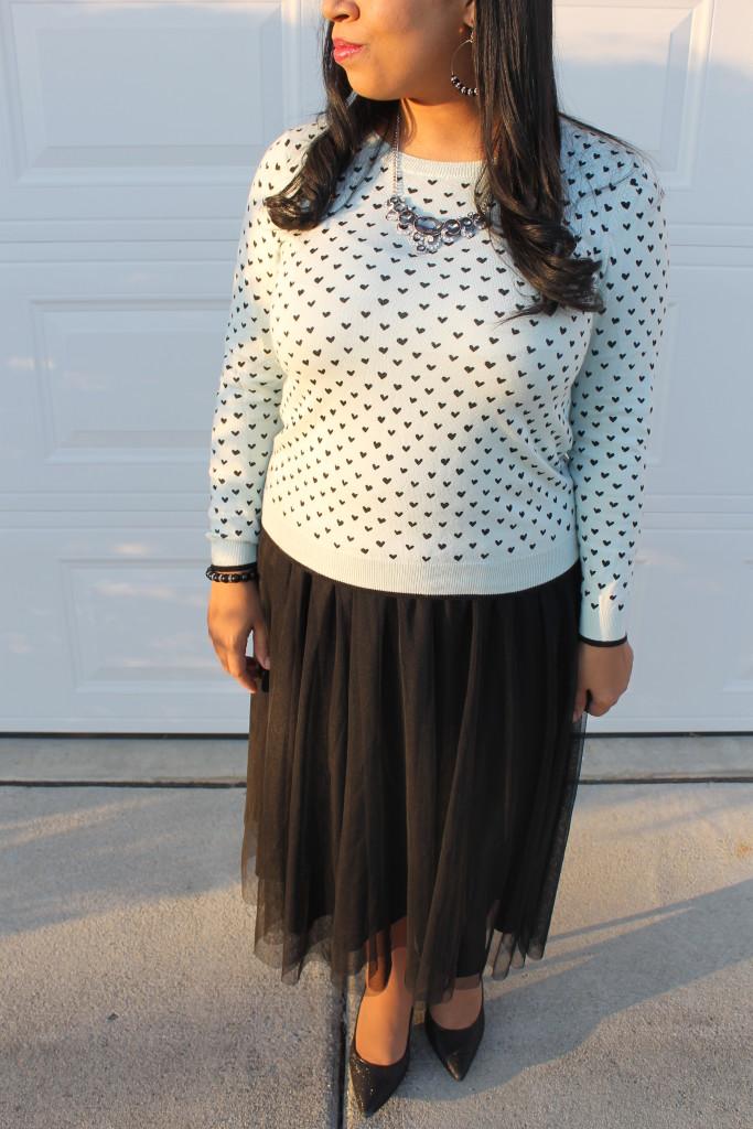 blue and black heart sweater with black tulle skirt modest holiday outfit idea
