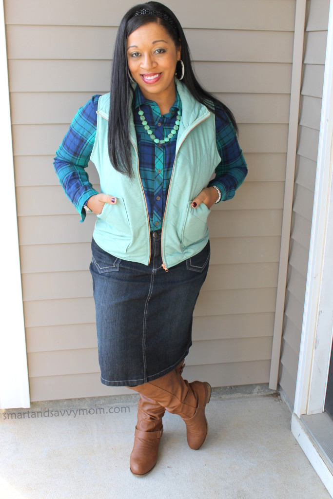 navy and green plaid button up with denim skirt, mint vest and cognac boots, modest outfit
