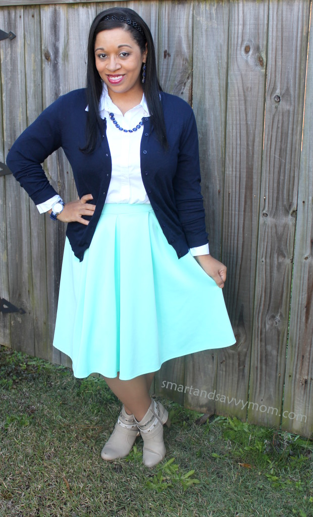 navy blue cardigan and mint pleated skirt modest outfit idea for fall with taupe boots