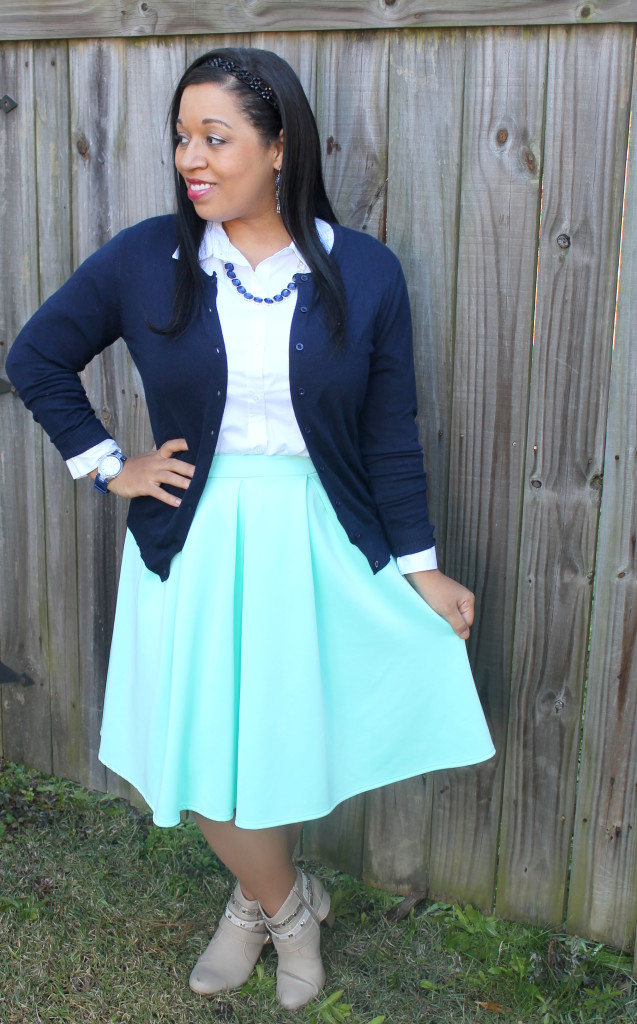 navy cardigan and mint pleated skirt modest outfit idea for fall, winter with taupe boots