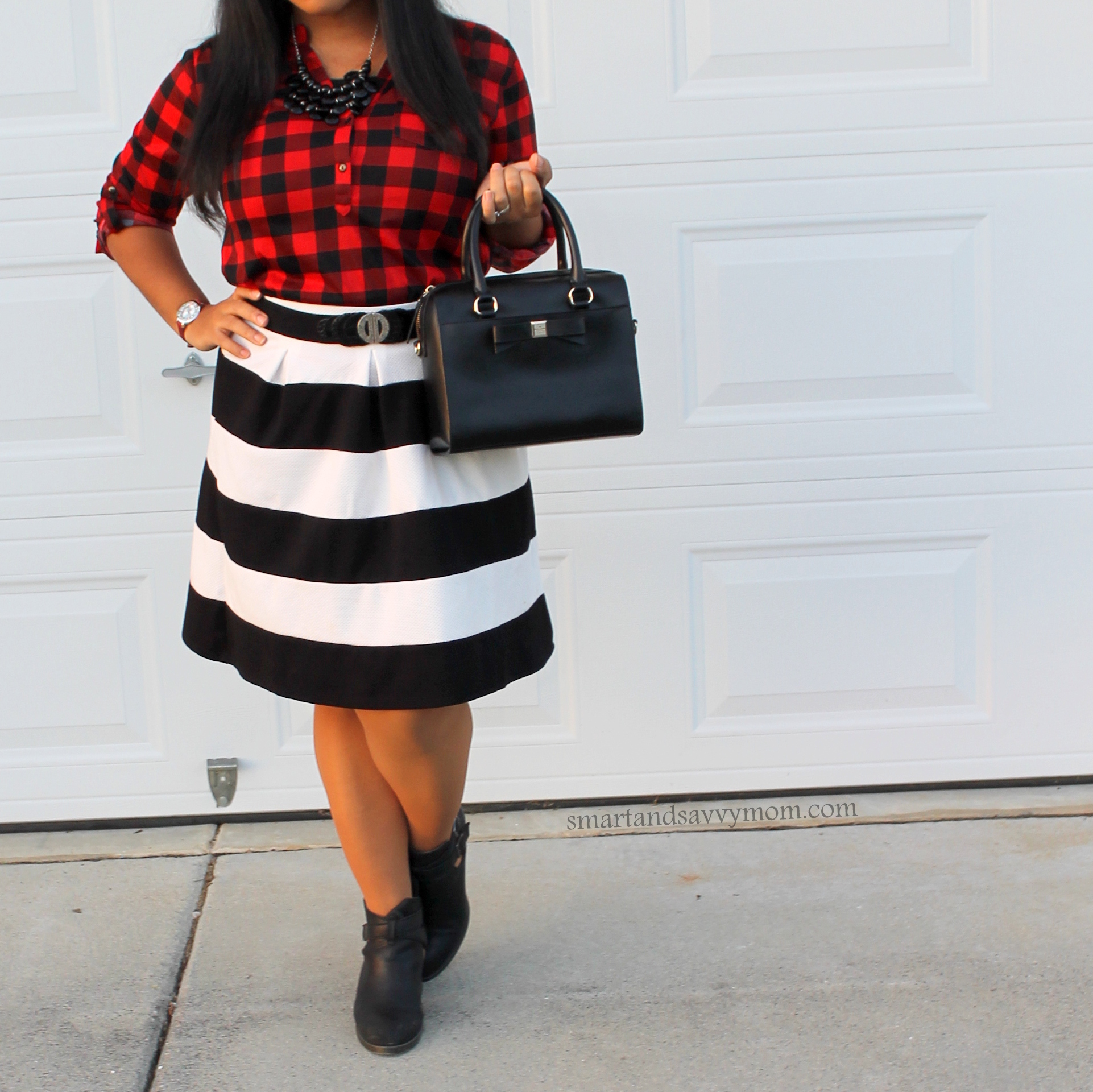 buffalo plaid easy outfit with black and white stripe skirt, kate spade bow front bag and leather booties, modest outfit inspo