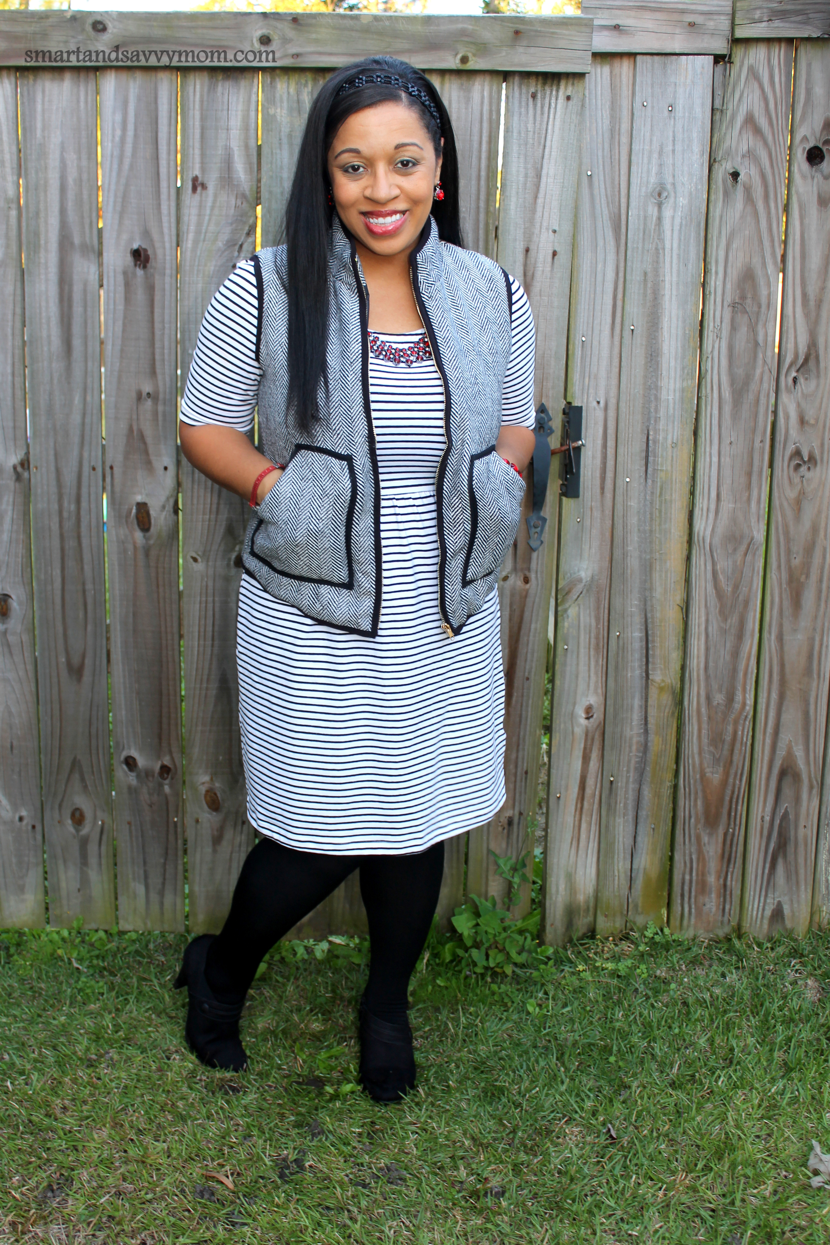 herringbone vest with black and white striped knee length dress from old navy modest outfit idea
