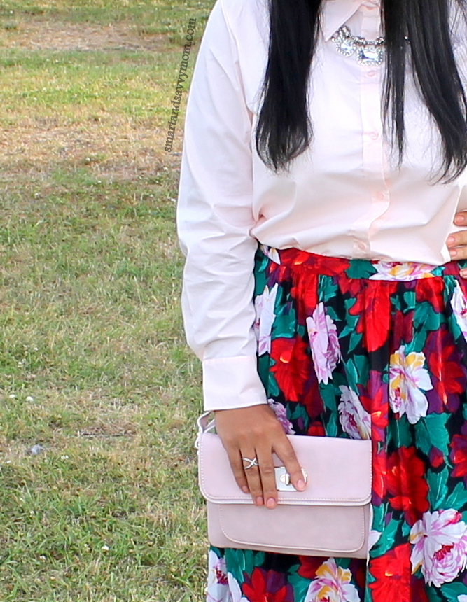 blush pink clutch from Cato fashions, dainty jewels and floral print skirt, modest outfit