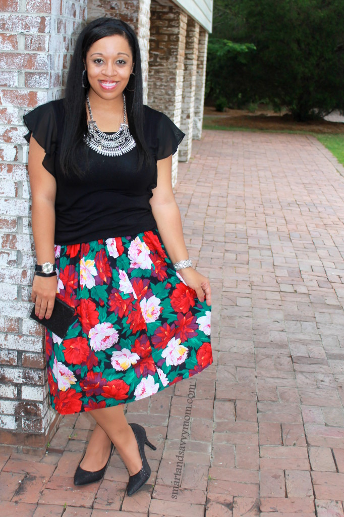 modern style with vintage pieces. Red, pink, green and black floral skirt with black top and statement necklace. Summer Modest fashion