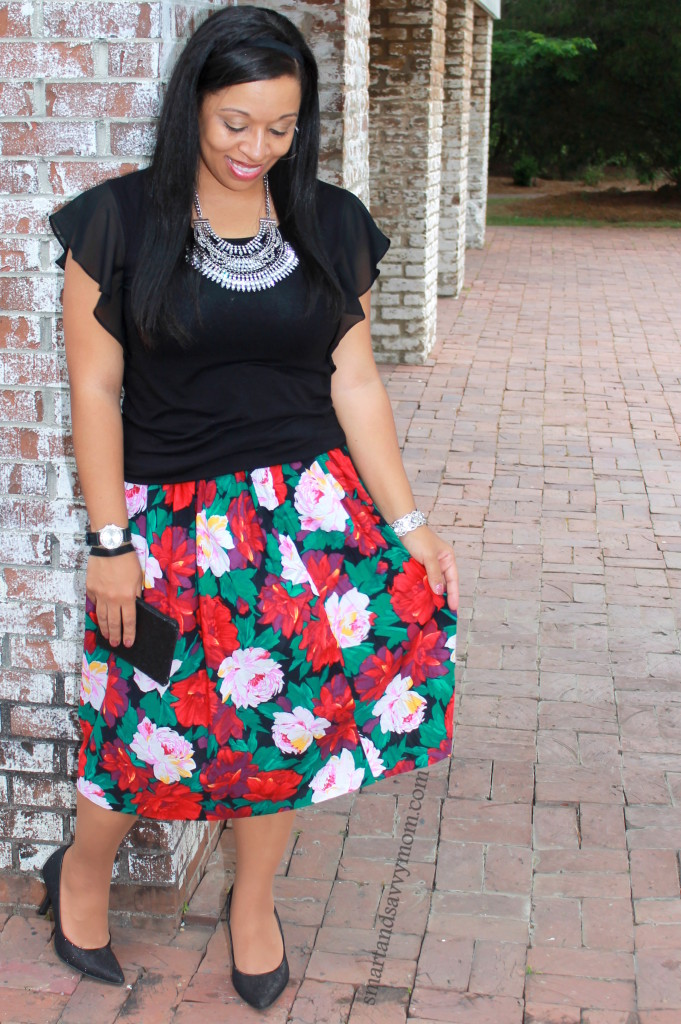 modern style with vintage pieces. Red, pink, green and black floral skirt with black top and statement necklace. Summer Modest fashion.